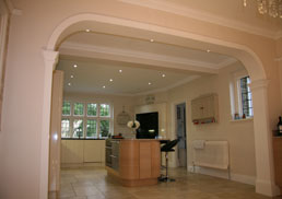 Bespoke arch, plain pilasters and kitchen cornice matched to existing. Kingswood, Banstead, KT20